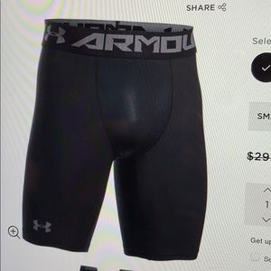 Under Armour long heat gear compression shorts. L